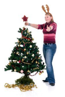 Free Happy Girl Decorating Christmas Tree Stock Photography - 6570962