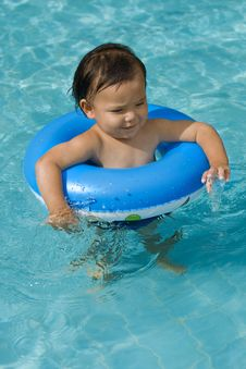Baby With Swimming Tires Royalty Free Stock Photo