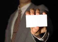 Free Business Man Holding Visiting Card Stock Image - 6574631