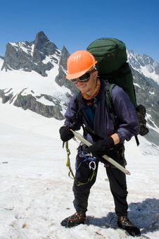 Happy Climber In Orange Helmet Royalty Free Stock Photography