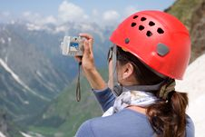 Free Girl Making A Photo In Mountains Royalty Free Stock Photography - 6574827