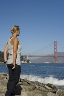 Woman Staring At Golden Gate Stock Image