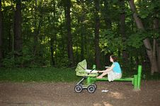 Mother With Baby Carriage Stock Photos