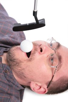 Lying Man Holds In Mouth Ball For Golf Royalty Free Stock Photos