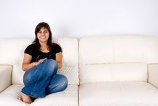 Free Beautiful Young Girl On Sofa Royalty Free Stock Photos - 6579768