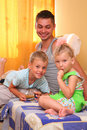 Free Children With Father Sitting On Bed In Room Stock Photo - 6581780