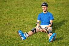 Free Guy In Rollerblades Sits On Grass Stock Photo - 6580600