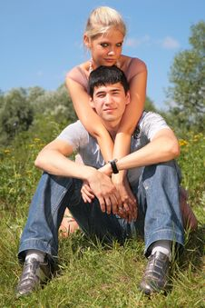 Couple Sits On Grass Stock Photos