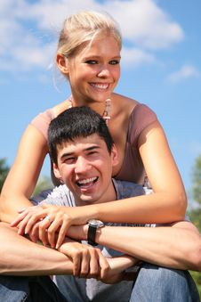 Girl Embraces Boy From Back Royalty Free Stock Photography