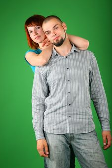 Girl With Red Hair Embraces Guy Behind Royalty Free Stock Photos