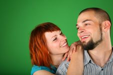 Girl With Red Hair Embraces Guy For Shoulder Royalty Free Stock Photography