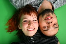 Girl With Red Hair And Guy Lie Head To Head Stock Photos