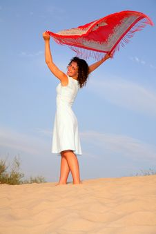 Girl On Sand With Shawl In Hands Stock Images