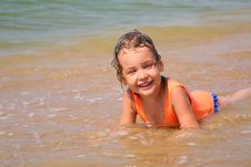 Free Little Girl Lies In Waves Stock Photography - 6582242
