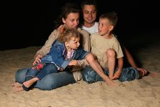 Free Parents With Children Sit On Sand At Night Stock Photos - 6582423