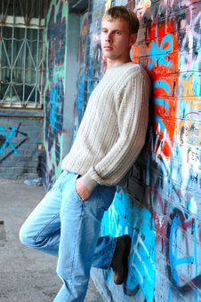 Free Young Stylish Man Stand Near Graffiti Brick Wall. Stock Photos - 6582633