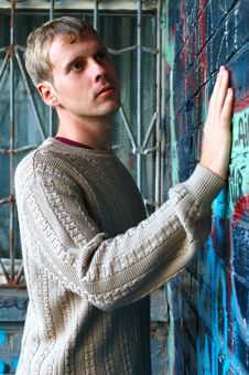 Free Young Stylish Man Stand Near Graffiti Brick Wall. Royalty Free Stock Photos - 6582668