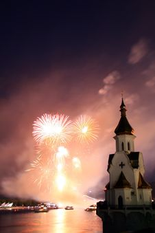 Firework And Church On River Stock Photo