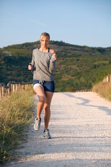 Free Woman Jogging In A Hilly Trail Stock Images - 6584704