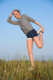 Free Stretching In A Hilly Meadow Royalty Free Stock Image - 6584796