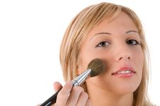 Young Woman Applying Make Up. Royalty Free Stock Images