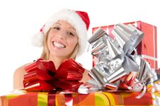 Girl With Santa S Hat And Colorful Christmas Gifts Royalty Free Stock Image