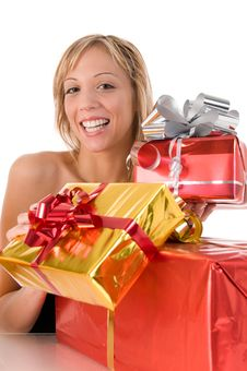 Free Young Woman Offers Xmas Gifts Stock Image - 6584901