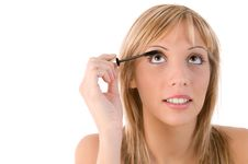 Free Girl Applying Mascara. Make Up Stock Photos - 6585273