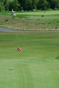 Free Golf Green With Red Flag Royalty Free Stock Photography - 6585597