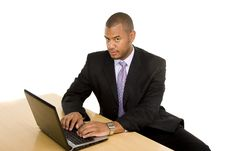 Free Serious Businessman At Desk Working On Laptop Stock Images - 6586424