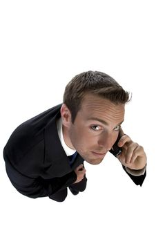 Businessman Busy On Phone Call And Looking Upwards Stock Photography