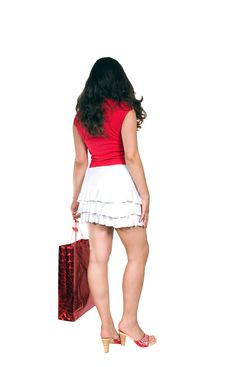 Attractive Brunette Girl From Behind With Bag Royalty Free Stock Image