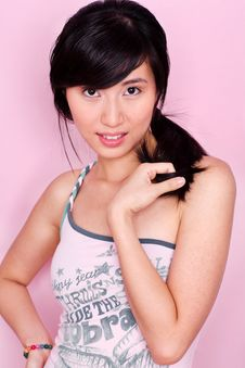 Free Coy Asian Girl In Pastels Royalty Free Stock Photo - 6593775
