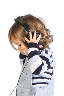 Free Beauty A Little Girl Listening Music Royalty Free Stock Photo - 6593815