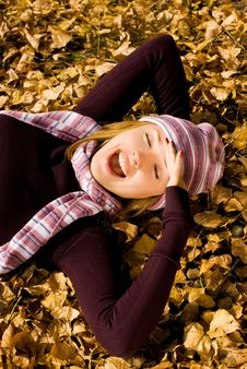 Happy Girl On The Grass In The Park Stock Photo
