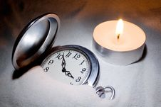 Watch Covered With Sand And A Candle Royalty Free Stock Photo