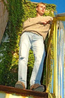 Young Stylish Man Near Overgrown Wall. Stock Photo