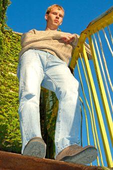 Young Stylish Blonde Man Near Overgrown Wall. Stock Photo