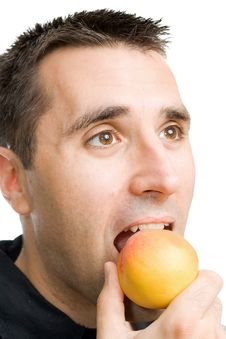 Young Man Eating A Peach Royalty Free Stock Image