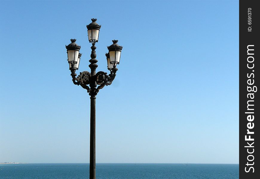 The ocean and the streetlamp