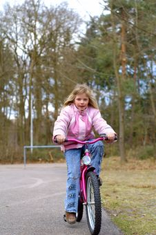Free Young Girl On Her Bike Royalty Free Stock Photography - 660597