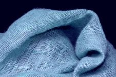 Free Blue Burlap Canvas On Dark Background Royalty Free Stock Photos - 666528