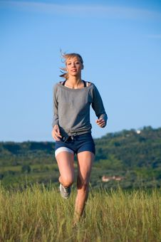 Free Jogging In A Hilly Meadow Royalty Free Stock Photography - 6600637