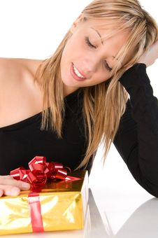 Free Young Beautiful Girl Looks At The Gift Stock Image - 6600911