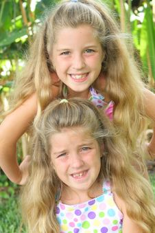 Free Stacked Sisters Upclose Stock Photo - 6601130
