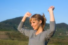 Free Young Woman Spreading Arms To  Blue Sky Royalty Free Stock Photography - 6601317