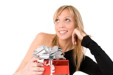 Free Beautiful Girl With  Gift  Looks Up Stock Image - 6601751
