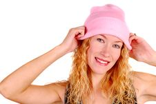 Young Woman Trying On A Pink Knit Hat Stock Images