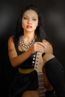 Female Rocker With Her Guitar Royalty Free Stock Photos
