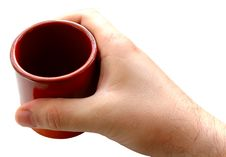 Free Pottery Cup In Man S Hand. Royalty Free Stock Photography - 6604507